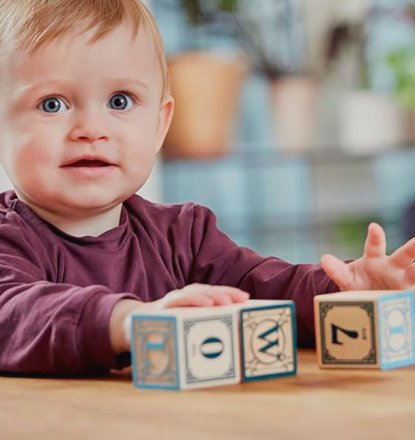 Child conceived after sperm donation playing with building blocks