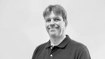 Portræt af Tissue Bank Director for Cryos USA Sperm and Egg Bank, Corey Burke