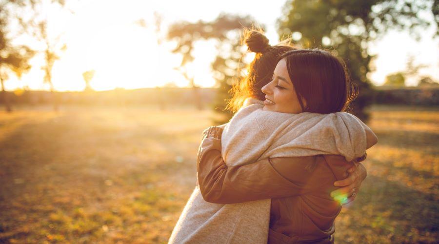 Grateful woman hugging Cryos egg donor