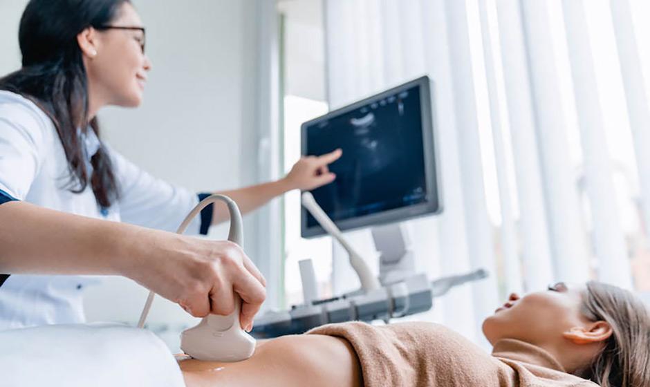 Woman having ultrasound during egg freezing process