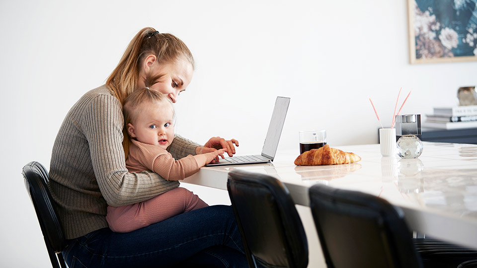 Mother with child and laptop ordering shipping and delivery of donor eggs for fertility treatment