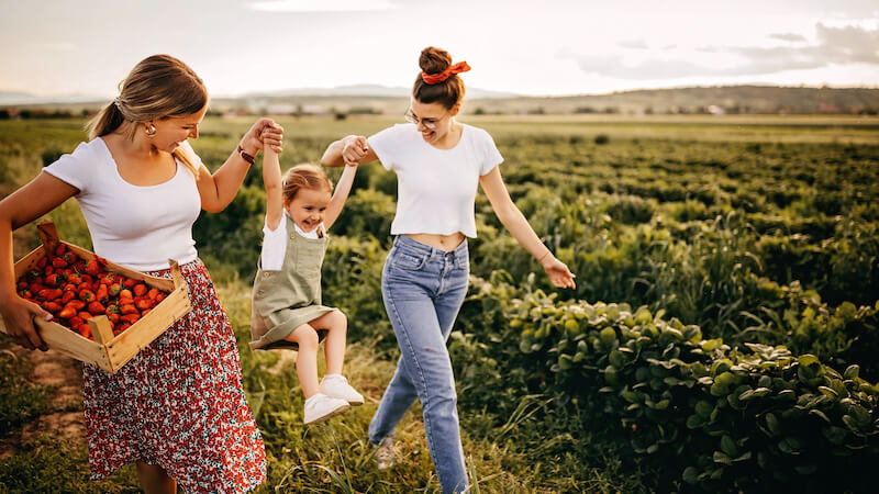 Lesbian mothers with their child conceived with the help of a sperm donor
