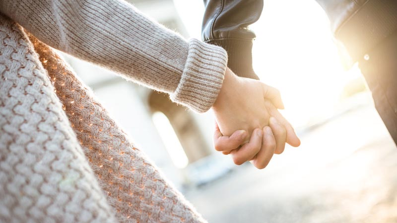 Infertile couple holding hands and supporting each other through male infertility