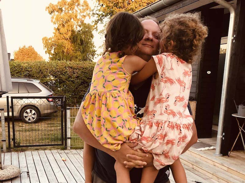 Tanja is a solo mother and has found the man in her life - here he hugs her twin girls