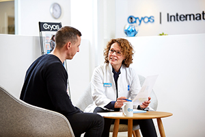 A Cryos donor coordinator having a conversation with a donor – Photo from the Cryos press kit.