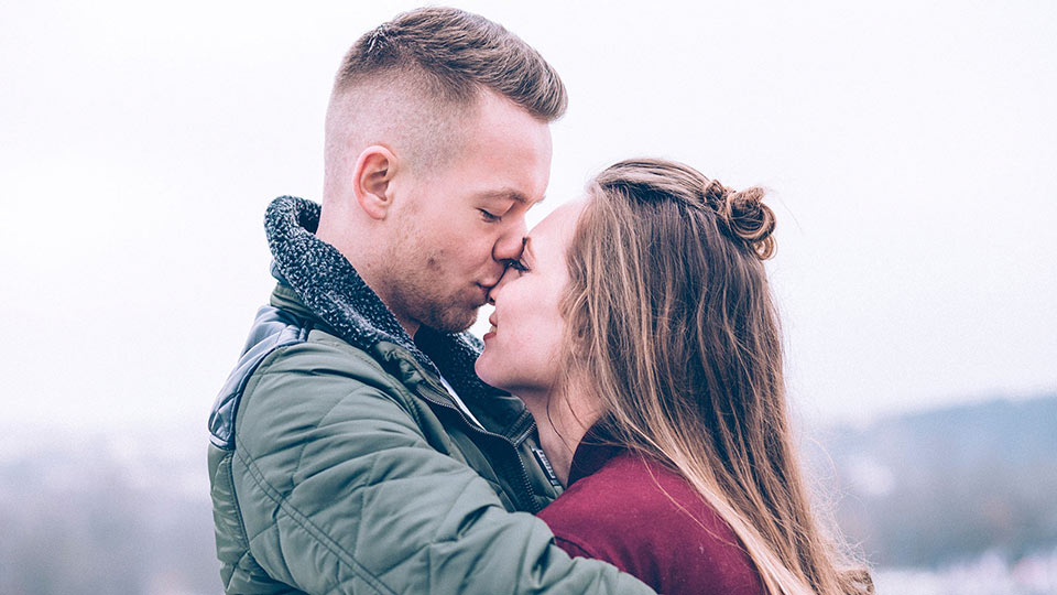 Infertile couple kissing and thinking about having a child by using donor sperm to conceive