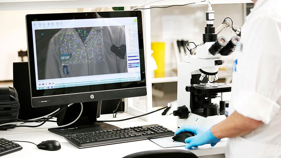 Cryos laboratory technician assessing sperm motility and sperm count through the CASA system