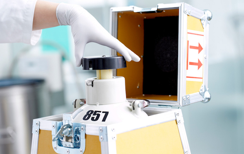 Laboratory technician from Cryos prepares a nitrogen tank for shipment to a fertility clinic